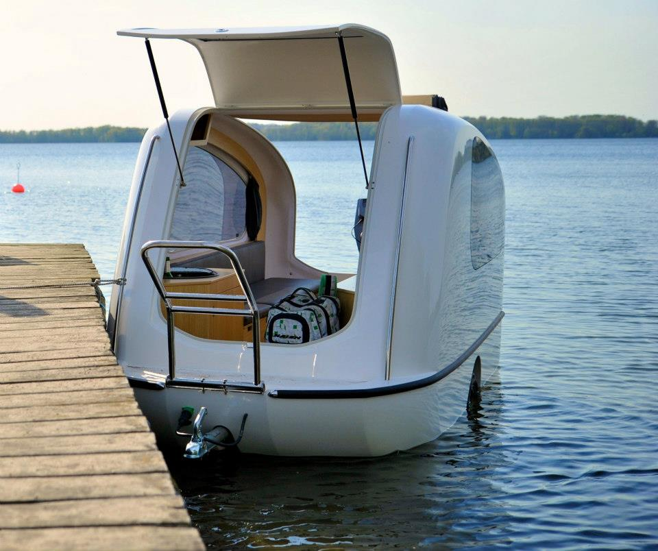 An Adorable Tiny House Boat Exists For You To Travel Around In