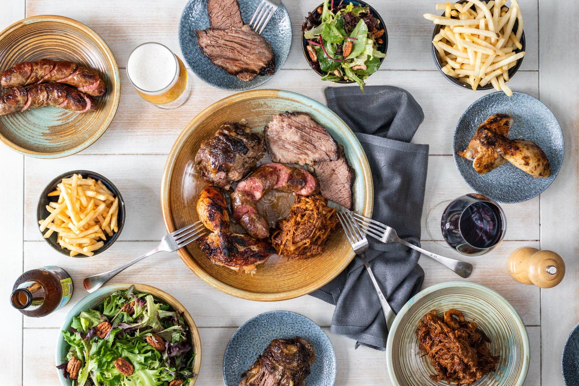 Flatlay of menu items at NOLA Smokehouse and Bar restaurant Barangaroo